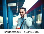 young businessman on rail... | Shutterstock . vector #623483183