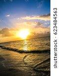sunrise or sunset on the beach | Shutterstock . vector #623484563