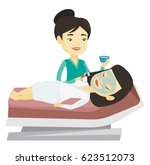 asian cosmetologist applying... | Shutterstock .eps vector #623512073