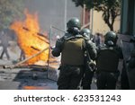 riot police during a student... | Shutterstock . vector #623531243