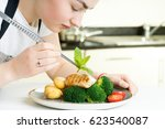 concentrated female chef... | Shutterstock . vector #623540087
