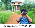 Little Boy Stand On The Nature...