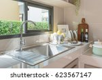 stainless steel sink with... | Shutterstock . vector #623567147