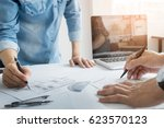 architects engineer discussing... | Shutterstock . vector #623570123