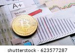 a golden bitcoin on graph and... | Shutterstock . vector #623577287