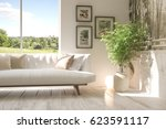 white room with sofa and green... | Shutterstock . vector #623591117