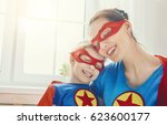 mother and her child playing... | Shutterstock . vector #623600177