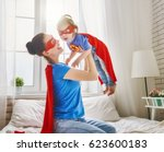 mother and her child playing... | Shutterstock . vector #623600183