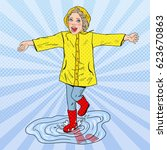 happy girl running in puddles... | Shutterstock .eps vector #623670863