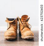 pair of old yellow working boots | Shutterstock . vector #623702603