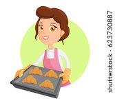 cooking woman with croissant | Shutterstock .eps vector #623730887