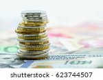 stack of coins on a pile of... | Shutterstock . vector #623744507