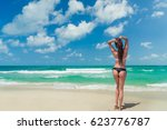 beautiful woman at the beach in ... | Shutterstock . vector #623776787