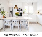 table in a fancy kitchen with... | Shutterstock . vector #623810237
