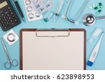 topview of black paper on board ... | Shutterstock . vector #623898953