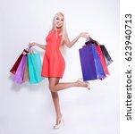 beautiful blonde to do shopping.... | Shutterstock . vector #623940713