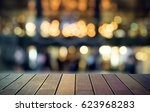 image of wooden table in front... | Shutterstock . vector #623968283