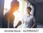 asian man smile when clink... | Shutterstock . vector #623983427