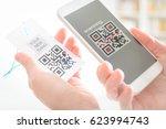 woman scanning qr code from a... | Shutterstock . vector #623994743
