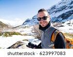 photographer outdoor in winter | Shutterstock . vector #623997083