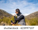 man photographed mountains in... | Shutterstock . vector #623997107