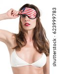 Small photo of Young woman wearing eyemask. American Dream concept. Isolated on white background.