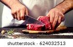 man cutting beef meat. | Shutterstock . vector #624032513