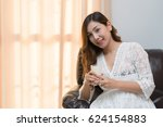 pregnant woman with milk in her ... | Shutterstock . vector #624154883