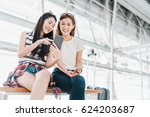 two happy asian girls using... | Shutterstock . vector #624203687