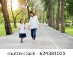 asian mother and daughter... | Shutterstock . vector #624381023