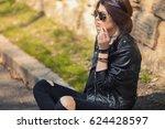 beautiful young woman smoking... | Shutterstock . vector #624428597