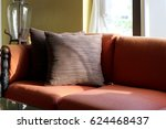 brown pillows on red sofa in... | Shutterstock . vector #624468437