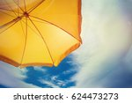 yellow umbrella against blue... | Shutterstock . vector #624473273