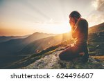 man praying at sunset mountains ... | Shutterstock . vector #624496607