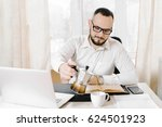 business man with glasses pours ... | Shutterstock . vector #624501923
