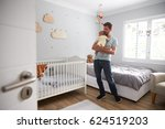 father comforting newborn baby... | Shutterstock . vector #624519203