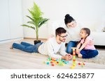 family playing with toy blocks | Shutterstock . vector #624625877