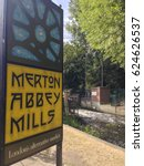 Small photo of SOUTH LONDON, UK- JUNE 9, 2016: Merton Abbey Mills market. Sign and weir at entrance off Merantun Way. Local market with restaurants, craft and art shops.
