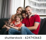 happy young family playing... | Shutterstock . vector #624743663