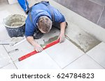 tiling floor   wall. the tiler... | Shutterstock . vector #624784823