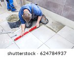 tiling floor   wall. the tiler... | Shutterstock . vector #624784937