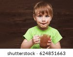 the kid drinking cocoa at home. | Shutterstock . vector #624851663