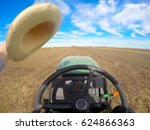 Small photo of Agriculture. Farmer driving tractor on the field. Driver point of view. Agronomy.