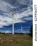Small photo of Series of wind turbines provide alternate energy.