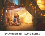 child girl playing meditates in ... | Shutterstock . vector #624956867