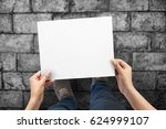 close up of hands holding paper ... | Shutterstock . vector #624999107