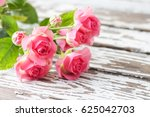 pink roses on a wooden... | Shutterstock . vector #625042703