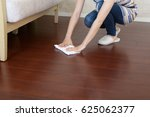 woman cleaning the house | Shutterstock . vector #625062377