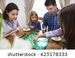 happy young family plaing board ... | Shutterstock . vector #625178333