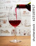 glass of full bodied red wine... | Shutterstock . vector #625185917